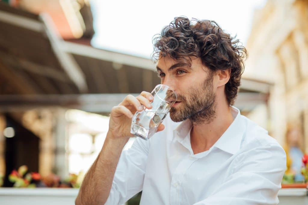 Portrait,Of,A,Young,And,Masculine,Man,Drinking,A,Water